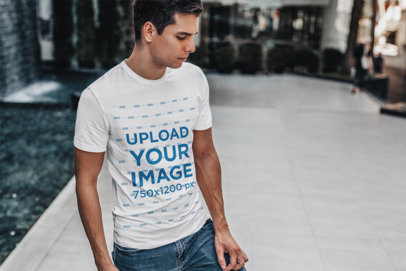Transparent T-Shirt Mockup Featuring a Man Standing by a Modern Fountain 428-el