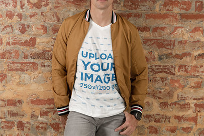 Transparent V-Neck T-Shirt Mockup of a Young Man Posing Against a Brick Wall 46530-r-el2