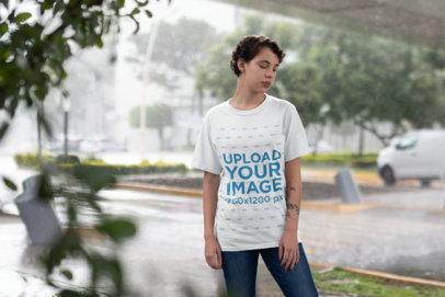 Transparent T-Shirt Mockup Showing a Girl Under a Bridge while Raining 22737