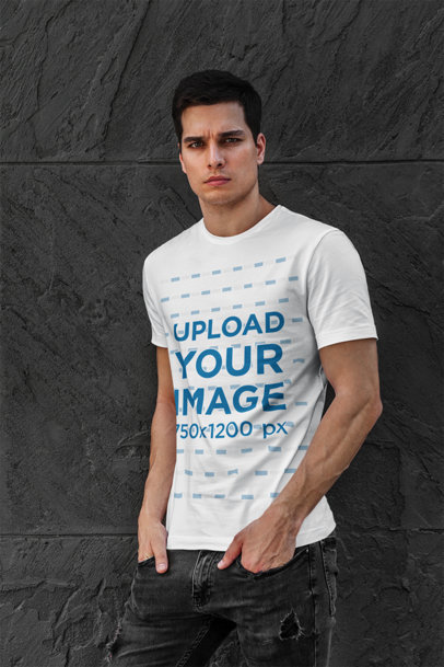 Transparent T-Shirt Mockup Featuring a Serious-Looking Man Posing Against a Dark Stone Wall 427-el