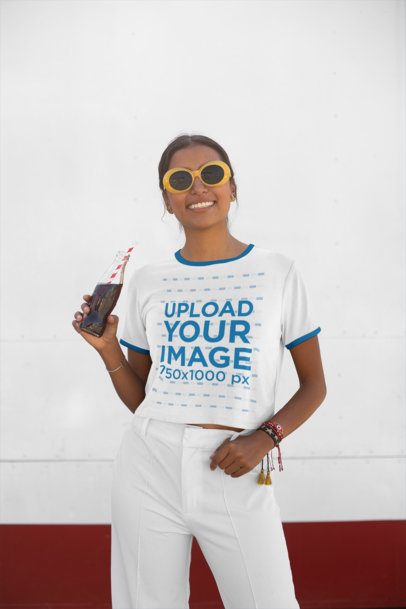 Transparent Crop Top Ringer Shirt Mockup Featuring a Trendy Woman Drinking a Soda 27274