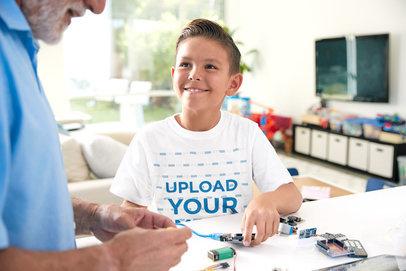 Transparent T-Shirt Mockup of a Happy Kid Learning Robotics 44626-r-el2