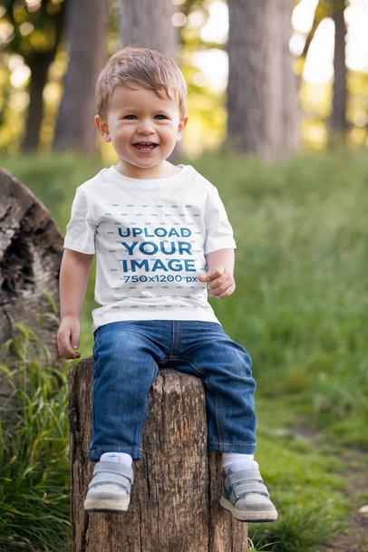 Transparent T-Shirt Mockup of a Toddler Sitting on a Log 2911-el1