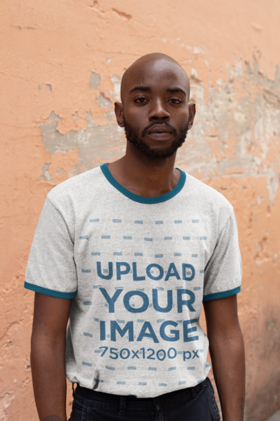 Transparent Ringer T-Shirt Mockup Featuring a Bearded Man Against an Old Wall 27900