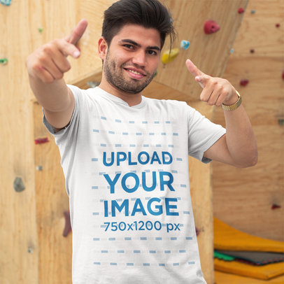 Transparent Mockup of a Cool Guy Wearing a T-Shirt While Near a Climbing Wall a16130