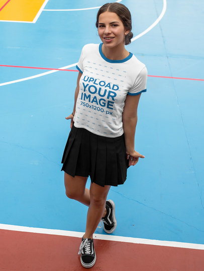 Transparent Smiling Girl Wearing a Ringer Round Neck Tee Template While at a Colorful Court a17059