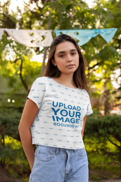 Transparent Mockup of a Woman Wearing a Cropped T-Shirt at the Park 28566