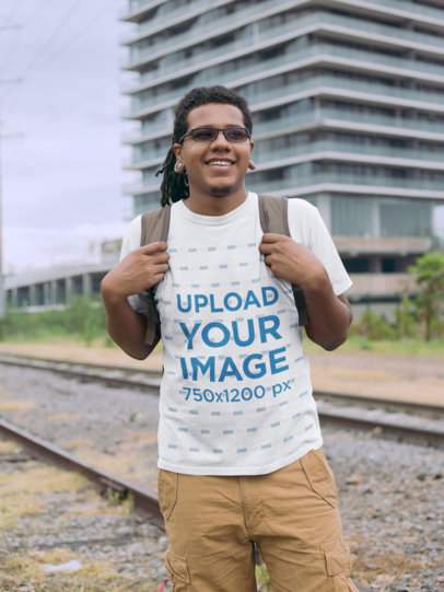 Transparent T-Shirt Mockup of a Man with Locs by a Railway 22054