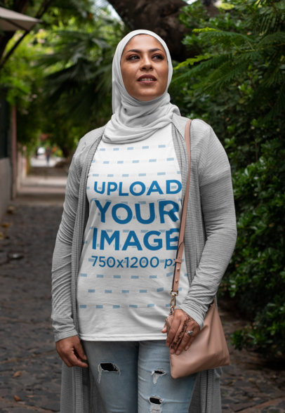 Transparent T-Shirt Mockup of a Woman Posing Proudly with a Hijab on a Street 28379