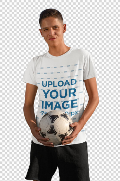 Transparent T-Shirt Mockup of a Teenage Boy Holding a Soccer Ball 33554
