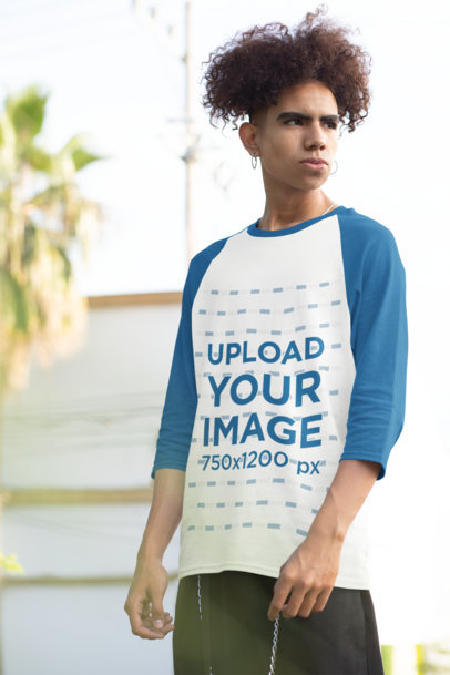 Transparent Three-Quarter Sleeves Raglan Tee Mockup of a Young Man Posing 30214