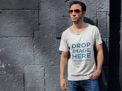 Transparent T-Shirt Mockup of a Young Man Leaning on a Stone Wall 6495a