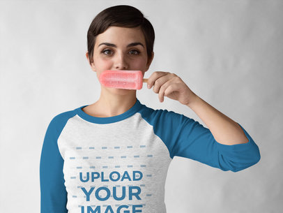 Transparent Girl Wearing a Raglan Tee Mockup while Holding a Popsicle Against her Mouth a17536