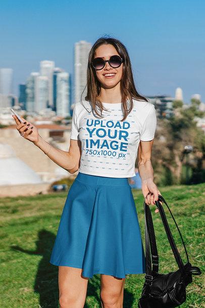 Transparent Crop Top Mockup Featuring a Woman Posing Against a Big City Setting 39763-r-el2