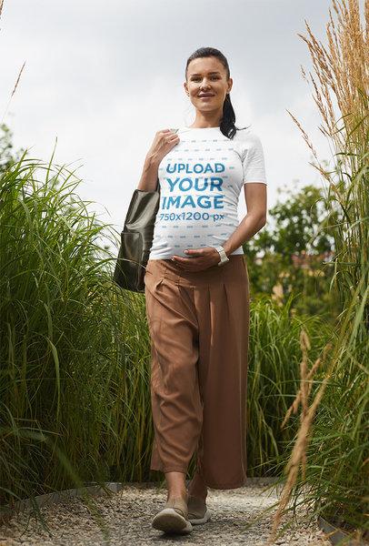 Transparent Tee Mockup of a Pregnant Woman Walking Through a Garden 39259-r-el2