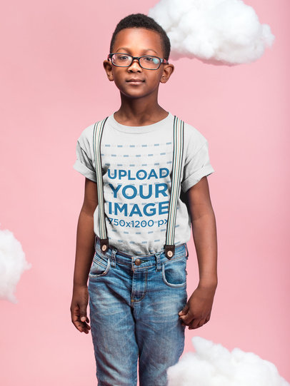 Transparent Black Boy with Glasses Wearing a T-Shirt Mockup Against a Pink Background with Clouds a19726
