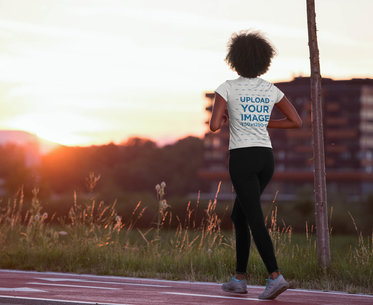 Transparent Back View T-Shirt Mockup of a Woman Walking on a Running Track 45392-r-el2