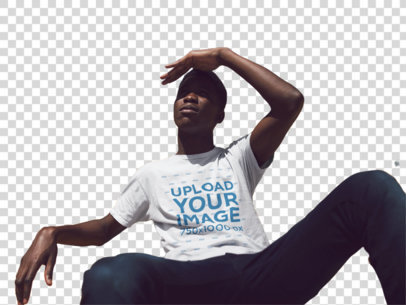 Transparent Mockup of a Black Dude Sitting in a Stadium Taking a Look at the Place While Wearing a T-Shirt a14252