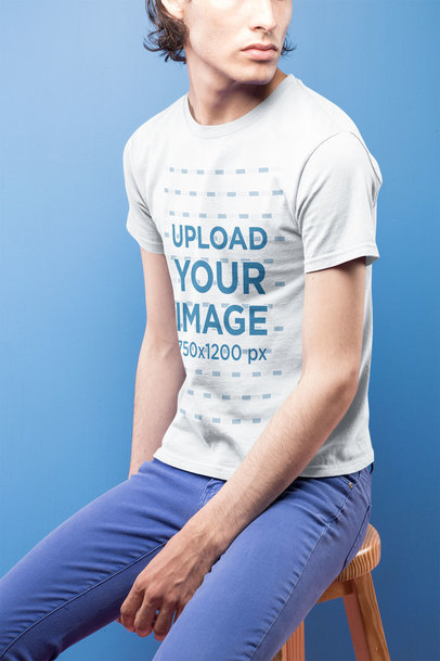 Transparent Closeup of a Dude Wearing a Short Sleeved T-Shirt Mockup Against a Blue Background a19666
