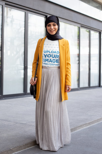 Transparent T-Shirt Mockup of a Woman With a Hijab Walking in the City 28297