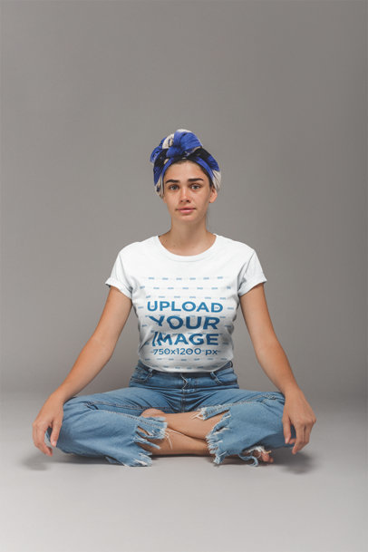 Transparent Girl with a Headwrap Wearing a T-Shirt Mockup Sitting in Lotus Position a20859