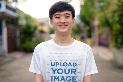 Transparent T-Shirt Mockup Featuring a Smiling Teenage Boy 40312-r-el2