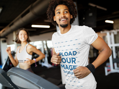 Transparent Heather Tee Mockup of a Fit Man Jogging on a Treadmill 42969-r-el2