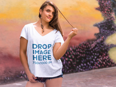 Transparent Girl Standing in Front of a Mural T-Shirt Mockup a7617