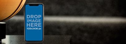iPhone X Mockup Standing on a Coffee Table a17512