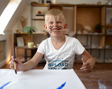 V-Neck T-Shirt Mockup of a Boy With a Mustache Painting M16705-r-el2