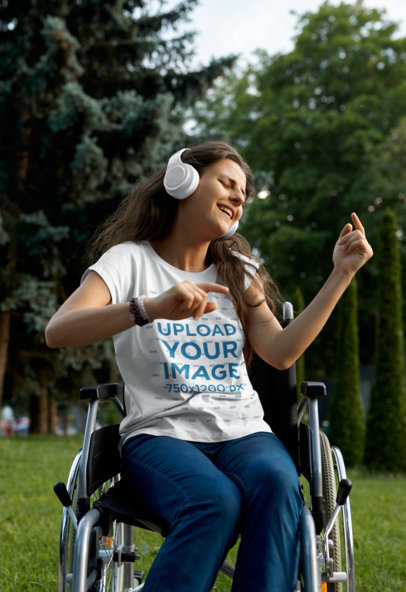 T-Shirt Mockup of a Woman Using a Wheelchair While Enjoying Some Music M17376-r-el2
