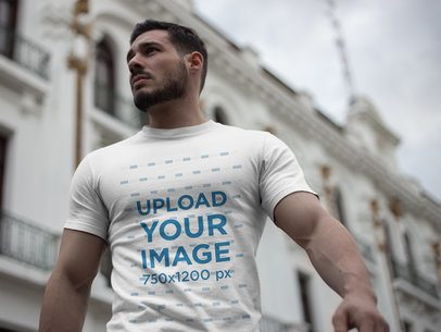 Strong Handsome Man Wearing a Tshirt Mockup While Walking in the City a17664