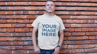 Middle-Aged Man Standing Against a Bricks Wall Wearing a Round Neck T-Shirt Video Mockup a12751