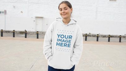Front Shot of a Woman Wearing a Pullover Hoodie Video Mockup at an Industrial Zone a13117