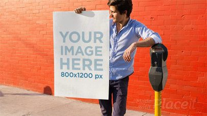 Young Man Holding a Poster Stop Motion While Leaning on a Parking Meter a13652