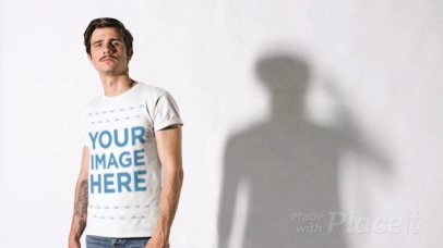 White Man Wearing a T-Shirt Cinemagraph Mockup Against his Moving Shadow a13531