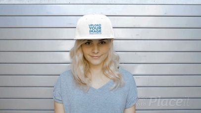 Young Lady Wearing a Snapback Hat Video Standing Against a Metal Curtain a14140