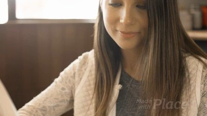 Gorgeous Girl Reading a Book Video While Having a Coffee on a Wooden Table a14015