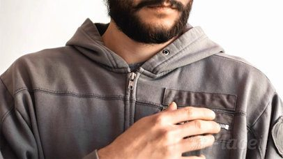 Hipster Dude Opens Takes out a Business Card Stop Motion Out of his Hoodie Pocket a13782