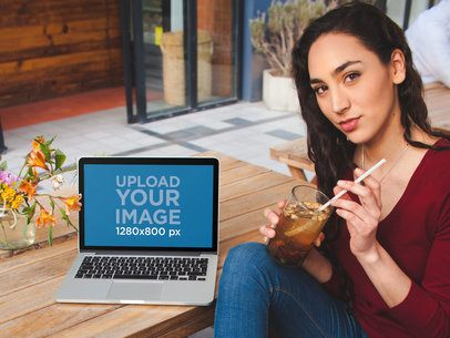 MacBook Mockup Featuring a Pretty Girl Drinking Iced Tea a19524