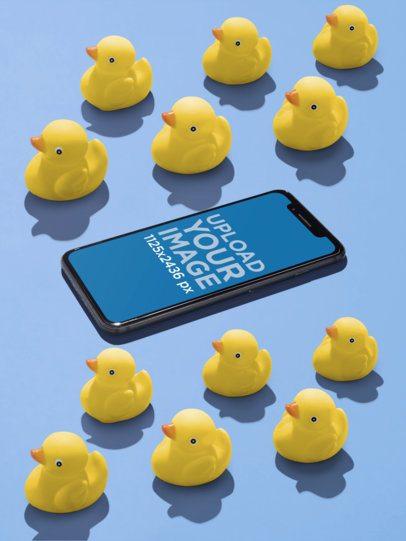 iPhone X Mockup Lying Near Rubber Ducks a19185