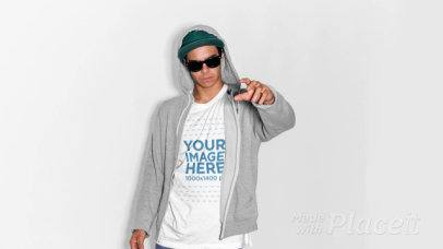 Guy Wearing a Hoodie with a T-Shirt Stop Motion and Sunglasses Pointing Away a13213