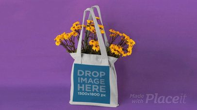 Tote Bag in Stop Motion on a Purple Room While Flowers Disappear a13665