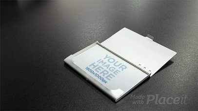 Stop Motion of a Business Card in a Card Holder on a Black Surface a13710