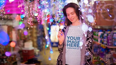 Young Woman Wearing a T-Shirt Stop Motion Standing in Between Christmas Lights a13193