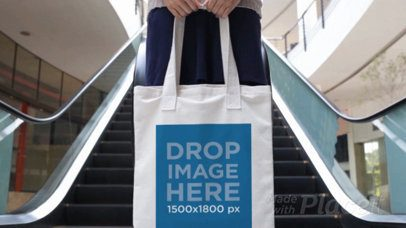 Girl Holding a Tote Bag Cinemagraph While Escalators Moving In The Back a13769