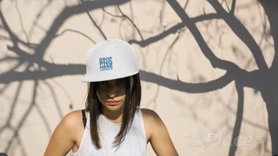 Girl Wearing a Snapback Hat Video Under a Tree Shadows a14201