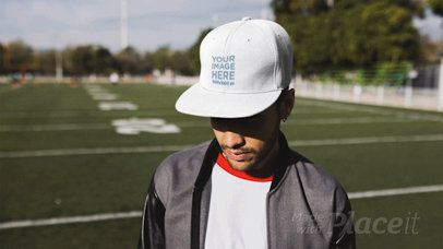 Trendy Guy Wearing a Hat in Stop Motion at a Football Field a13695