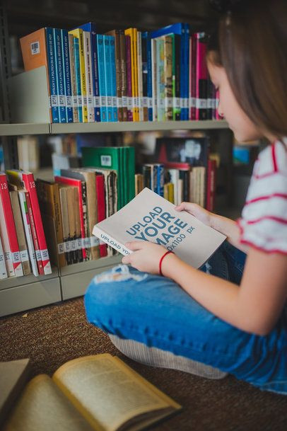Girl Looking at a Book Mockup at the Library a19272
