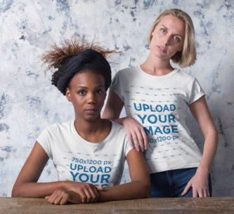 Mockup of two Women Wearing Customizable T-Shirts 19903